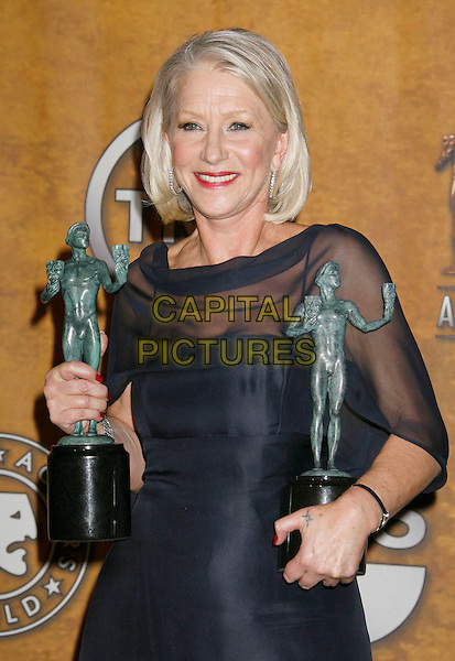 "HELEN MIRREN.winner of the ""Female Actor In A TV Movie Or MiniSeries"" for ""Elizabeth I"" and ""Female Actor In A Leading Role"" for ""The Queen"" .13th Annual Screen Actors Guild (SAG) Awards held at the Shrine Auditorium - pressroom,  Los Angeles, California, USA, 28 January 2007..press room half length navy blue silk satin long dress sheer sleeves trophies awards.CAP/ADM/RE.©Russ Elliot/AdMedia/Capital Pictures."