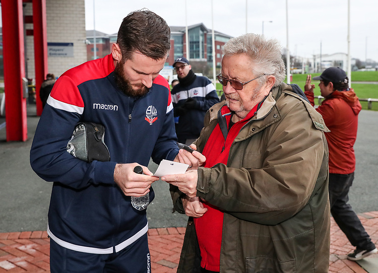 Bolton Wanderers' Jonathan Grounds signs an autograph for a fan<br /> <br /> Photographer Andrew Kearns/CameraSport<br /> <br /> Emirates FA Cup Third Round - Bolton Wanderers v Walsall - Saturday 5th January 2019 - University of Bolton Stadium - Bolton<br />  <br /> World Copyright © 2019 CameraSport. All rights reserved. 43 Linden Ave. Countesthorpe. Leicester. England. LE8 5PG - Tel: +44 (0) 116 277 4147 - admin@camerasport.com - www.camerasport.com