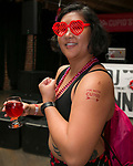 Allie shows off her tattoo during the Cupid's Undie Run to benefit Neurofibromatosis in Reno, Nev., Saturday, Feb. 8, 2020.