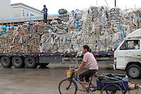 A lorry packed with plastic waste at Mai village, Shunde, China.  There is so much re-cycling in the area that the waste plastic spills out into streams and farmland polluting the environment.<br /> <br /> Photo by Richard Jones/ Sinopix