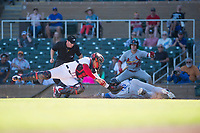 Salt River Rafters catcher Tres Barrera (12), of the Washington Nationals organization, applies the tag to Charles Leblanc (12) as he slides home in front of home plate umpire Junior Valentine as Lane Thomas (23) looks on during an Arizona Fall League game against the Surprise Saguaros at Salt River Fields at Talking Stick on November 5, 2018 in Scottsdale, Arizona. Salt River defeated Surprise 4-3 . (Zachary Lucy/Four Seam Images)