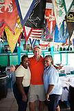 EXUMA, Bahamas. Locals inside the Staniel Cay Yacht Club in Stanley Cay.