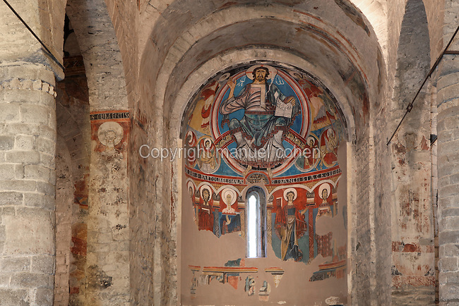 Low angle view of the nave and central apse with mural painting of Christ Pantocrator (replica), Sant Climent de Taull church, 1123, consecrated by bishop of Roda, Taull, province of Lleida, Catalonia. The church is one of the best examples of Romanesque architecture, known for its murals, which were removed to the MNAC (National Art Museum of Catalonia, Barcelona) in 1922. This church is part of the Catalan Romanesque churches of the Vall de Boí which were declared a World Heritage Site by UNESCO in November 2000. Picture by Manuel Cohen.