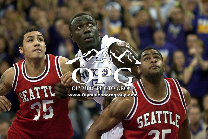 Jan 10, 2012:  Washington's #5 Aziz N'Diaye battles Seattle University's #35 Jarell Flora and #25 Eric Wallace under the basket.  Washington defeated Seattle University  91-83 at Alaska Airlines Arena Seattle, Washington..