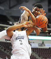 SMATH19P<br /> Kennedy Catholic's Sagaba Konate #50 lands on top of Math, Civics and Sciences Malik Archer #3 in the first quarter of the boys basketball PIAA Class A state championship game Friday March 18, 2016 at the Giant Center in Hershey, Pennsylvania. (WILLIAM THOMAS CAIN/For The Inquirer)