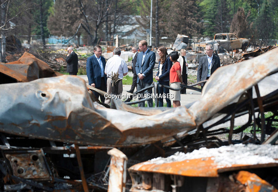 """PRINCE WILLIAM & KATE CANADA.tour the scene of a devastating bush fire on 15 May 2011, that resulted in the destruction of 372 homes and 300 apartments..Luckily no lives were lost, Slave Lake, Alberta_06/07/2011.Mandatory Credit Photo: ©DIASIMAGES. .**ALL FEES PAYABLE TO: """"NEWSPIX INTERNATIONAL""""**..No UK Usage until 03/08/2011.IMMEDIATE CONFIRMATION OF USAGE REQUIRED:.DiasImages, 31a Chinnery Hill, Bishop's Stortford, ENGLAND CM23 3PS.Tel:+441279 324672  ; Fax: +441279656877.Mobile:  07775681153.e-mail: info@newspixinternational.co.uk"""