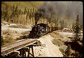 D&amp;RGW #480 K-36 crossing highway &amp; trestle in Monarch area.<br /> D&amp;RGW  Monarch area, CO