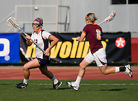 Charlie Finnigan (12) of Virginia sprints past Jacquelyn Duggins (2) of Virginia Tech during the first round of the ACC Women's Lacrosse Championship in College Park, MD.  Virginia defeated Virginia Tech, 18-6.
