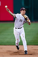 Eric Cheray (14) of the Missouri State Bears throws to first base during a game against the Oklahoma State Cowboys at Hammons Field on March 6, 2012 in Springfield, Missouri. (David Welker / Four Seam Images)