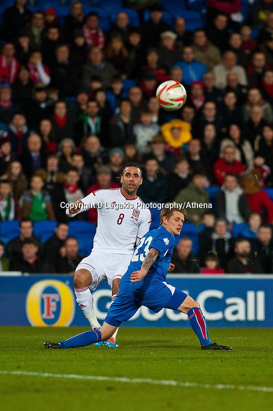 Wednesday 05 March 2014<br /> Pictured: ( L-R) Hai Robson kanu and Ari Freyr Skulason look for the ball <br /> Re: International friendly Wales v Iceland at the Cardiff City Stadium, Cardiff,Wales UK