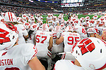 Wisconsin Badgers teammates huddle prior to the Advocare Classic NCAA college football game against the Alabama Crimson Tide Saturday, September 5, 2015, in Arlington, Texas. The Crimson Tide beat the Badgers 35-17. (Photo by David Stluka)