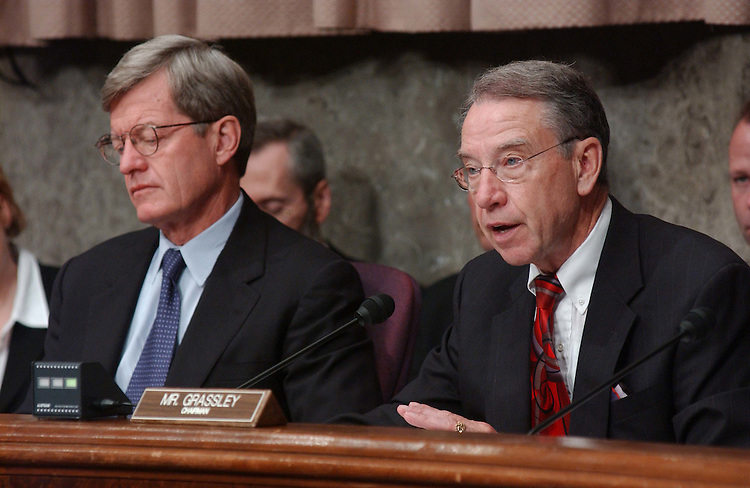 "10/21/03.TAX SHELTERS--Ranking Democrat Max Baucus, D-Mont., and Chairman Charles E. Grassley, R-Iowa,  during the Senate Finance Committee hearing on tax shelters titled ""Tax Shelters: Who's Buying, Who's Selling, and What's the Government Doing About It?"" .CONGRESSIONAL QUARTERLY PHOTO BY SCOTT J. FERRELL"