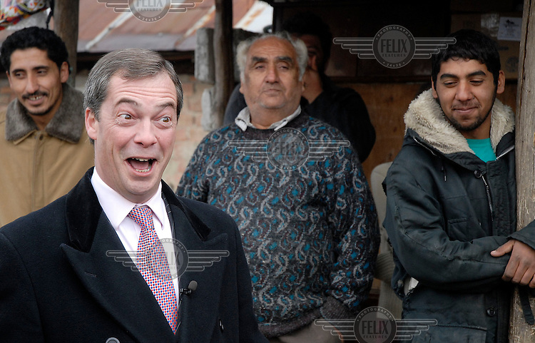 Nigel Farage, then leader of the UK Independence Party (UKIP), meets with members of the Roma community in Boldesti Scaieni in advance of Romania joining the European Union (EU). UKIP campaigns for Britain's withdrawal from the EU.