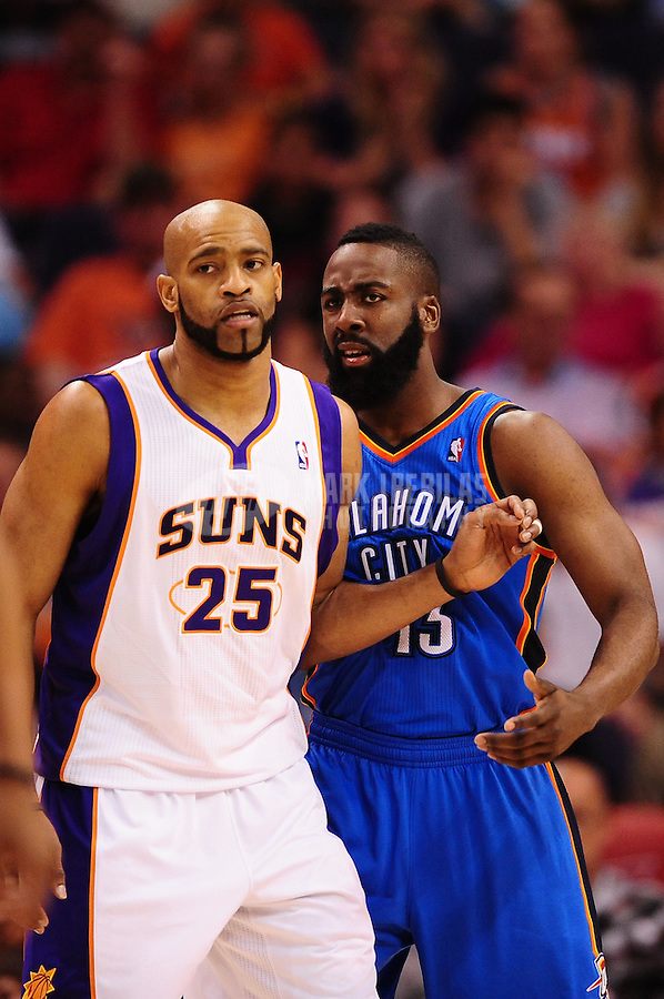 Mar. 30, 2011; Phoenix, AZ, USA; Phoenix Suns guard (25) Vince Carter against Oklahoma City Thunder guard (13) James Harden at the US Airways Center. Mandatory Credit: Mark J. Rebilas-.