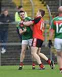 Martin Mc Mahon of Kilmurry Ibrickane and Tony Kelly of Clondegad tussle during their senior county final at Cusack park. Photograph by John Kelly.