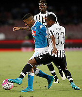 Calcio, Serie A: Napoli vs Juventus. Napoli, stadio San Paolo, 26 settembre 2015. <br /> Napoli&rsquo;s Marques Allan, left, is challenged by Juventus&rsquo; Patrice Evra during the Italian Serie A football match between Napoli and Juventus at Naple's San Paolo stadium, 26 September 2015.<br /> UPDATE IMAGES PRESS/Isabella Bonotto