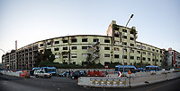 (This photo is an artificial stitch of 2 frames together. It can contain photographic mistakes & distortions. It is part of this story just to give the audience an idea of the size of the building. It is not meant to be for licensing).<br /> <br /> Rome, 10/12/2018. Today, the derelict former factory of the Penicillin in the east area of Rome was evicted and evacuated by a conspicuous number police officers in full riot gears (Polizia and Carabinieri) supported by fire fighters and the Rome municipal police. The abandoned and run-down factory once was home to an estimated 500 people, including migrants of different nationalities but also Italian families who lived in extreme poverty and poor hygienic and health conditions (presence of asbestos and others). The eviction, which saw the last 35 inhabitants took away on a bus by the police, was attended by the far-right leader of League (Lega), anti-immigration Minister of the Interiors and Deputy Prime Minister, Matteo Salvini. A group of protesters and activists held a rally against the eviction without a plan to rehouse the people of the Ex Penicillin but it was kept away from the main gate of the raw-concrete skeleton building.<br /> On the same day the 70th Anniversary of the Universal Declaration of Human Rights (UDHR, 1.), was marked outside the Colosseum projecting the Article 1 of the Declaration on the Historic symbol of Rome: <<All human beings are born free and equal in dignity and rights. They are endowed with reason and conscience and should act towards one another in a spirit of brotherhood>> (2.).<br /> <br /> 1. http://www.un.org/en/udhrbook/pdf/udhr_booklet_en_web.pdf<br /> 2. See my Story here: https://bit.ly/2PyLWeK