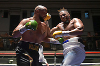 Ryan Charles (white shorts) defeats Phil Williams during a Boxing Show at York Hall on 30th June 2018
