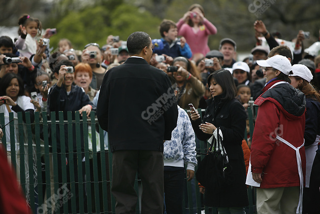 President Barack Obama, Michele Obama, and daughters Malia and Sasha attend the Easter Egg Roll events at the South Lawn of the White House, Washington D.C., April 13, 2009