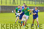 Castlegregory's Jimmy O'Grady been well marshalled by Aunascaul's Jack Farrell and Fionn Coakley in the West Kerry Senior Football championship in Aunascaul on Sunday