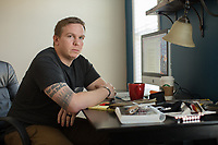 James LaPorta, a former Marine sergeant, now freelance journalist who has been reporting on and tracking the Marines United nude photo scandal. Portrait at his home and at a Gunshop in Jacksonville, NC on Friday, March 17, 2017. (Justin Cook for The New York Times)