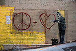 Peace + Heart graffiti on wal in San Franciscol