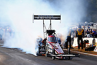 Aug. 16, 2013; Brainerd, MN, USA: NHRA top fuel dragster driver Spencer Massey during qualifying for the Lucas Oil Nationals at Brainerd International Raceway. Mandatory Credit: Mark J. Rebilas-