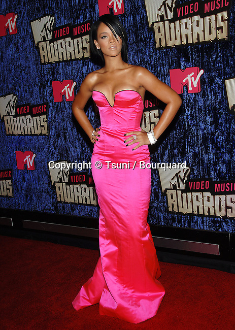 Rihanna at the MTV vma  Awards at the  at the The Palms Casino Resort in Las Vegas.<br /> <br /> full length<br /> fashion<br /> eye contact<br /> pink dress<br /> fuchsia