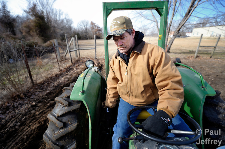 Steve Franco drives a tractor to plow ground for planting at the Cookson Hills Center, a ministry of The United Methodist Church in Cookson, Oklahoma. Franco, 51, started working at the center as part of his rehabilitation process with a local drug court.