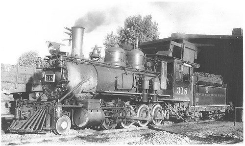 3/4 fireman's-side view of D&amp;RGW #318 in front of Montrose engine house.<br /> D&amp;RGW  Montrose, CO  Taken by Graham, Robert B. - 8/30/1938