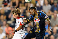 Conor Doyle (30) of D. C. United goes up for a header with Amobi Okugo (14) of the Philadelphia Union. The Philadelphia Union defeated D. C. United 2-0 during a Major League Soccer (MLS) match at PPL Park in Chester, PA, on August 10, 2013.