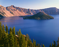 ORCL_084 - USA, Oregon, Crater Lake National Park, Sunrise on west rim of Crater Lake with Hillman Peak (left) and Llao Rock (right) overlooking Wizard Island.