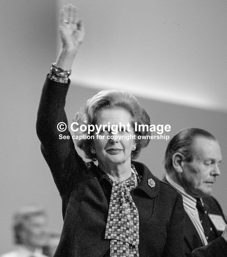 Only hours after surviving the Provisional IRA bombing of the Grand Hotel in Brighton, where she was staying, Margaret Thatcher, Prime Minister, UK, acknowledges the ovation following her speech at the Conservative Party's annual conference on Friday, 12th October 1984. 19840134MT8.<br /> <br /> Copyright Image from Victor Patterson, 54 Dorchester Park, Belfast, UK, BT9 6RJ<br /> <br /> t1: +44 28 9066 1296 (from Rep of Ireland 048 9066 1296)<br /> t2: +44 28 9002 2446 (from Rep of Ireland 048 9002 2446)<br /> m: +44 7802 353836<br /> <br /> victorpatterson@me.com<br /> www.victorpatterson.com<br /> <br /> Please see my Terms and Conditions of Use at victorpatterson.com . It is IMPORTANT that you familiarise yourself with them.<br /> <br /> Images used on the Internet incur an additional cost and must be visibly watermarked i.e. &copy;Victor Patterson within the body of the image and copyright metadata must not be deleted. Images used on the Internet have a size restriction of 4kbs and are chargeable at rates available at victorpatterson.com.<br /> <br /> This image is only available for the use of the download recipient i.e. television station, newspaper, magazine, book publisher, etc, and must not be passed on to any third party. It is also downloaded on condition that each and every usage is notified within 7 days to victorpatterson@me.com<br /> <br /> The right of Victor Patterson to be identified as the author is asserted in accordance with The Copyright Designs And Patents Act (1988). All moral rights are asserted.