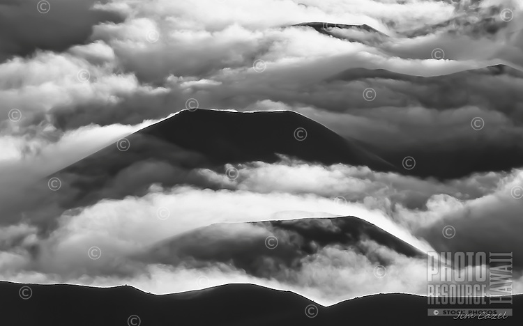 "Clouds roll over cinder cones in Haleakala ""Crater"" in Haleakala National Park, Maui."