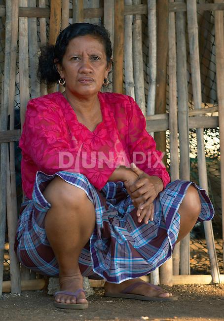 Missle-aged woman in Komodo Village, Komodo National Park
