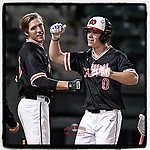 Cory Bivins (0) of the North Greenville Crusaders celebrates as he crosses the plate following his first collegiate home run in a game against the Queens University Royals on Tuesday, March 12, 2019, at Fluor Field at the West End in Greenville, South Carolina. North Greenville won, 14-3. (Tom Priddy/Four Seam Images)