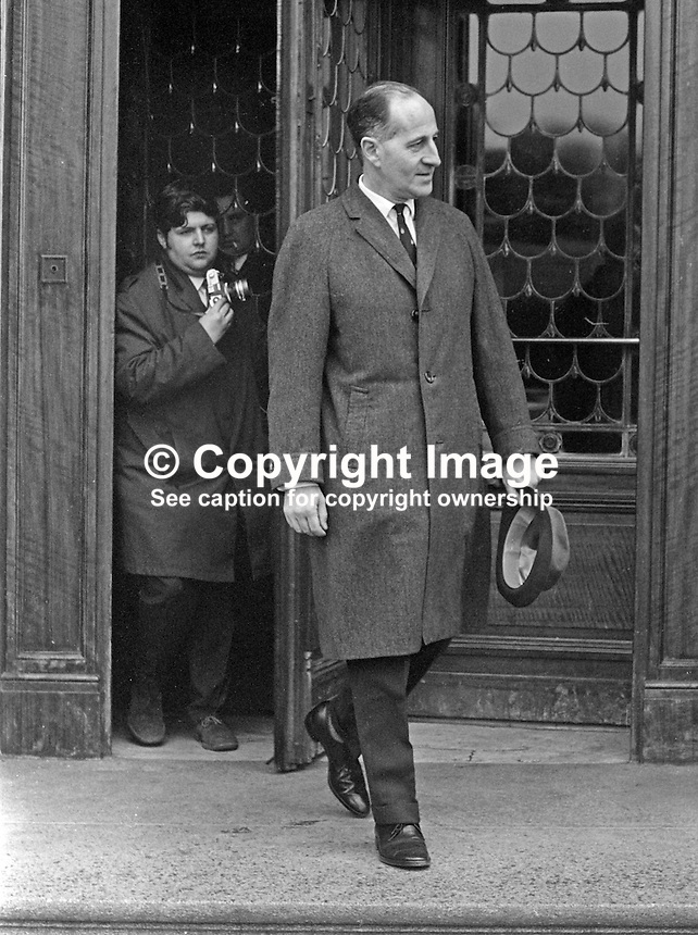 Belfast Telegraph photographer Fred Hoare pursues Ulster Unionist leader Captain Terence O'Neill as he leaves Parliament Buildings, Stormont, Belfast, N Ireland, 28th February 1969 after first meeting of the parliamentary party following the General Election of 24th February 1969, a few days earlier. At the meeting ten or twelve MPs who opposed his leadership walked out led by John D Taylor. 196902280082c<br /> <br /> <br /> Copyright Image from<br /> Victor Patterson<br /> 54 Dorchester Park<br /> Belfast, N Ireland, UK, <br /> BT9 6RJ<br /> <br /> t1: +44 28 90661296<br /> t2: +44 28 90022446<br /> m: +44 7802 353836<br /> e1: victorpatterson@me.com<br /> e2: victorpatterson@gmail.com<br /> <br /> www.victorpatterson.com
