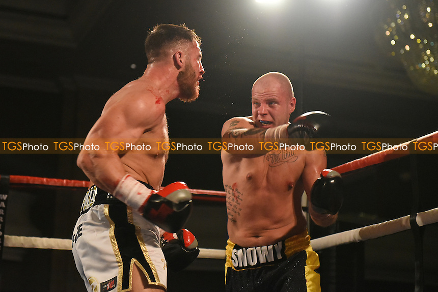 Darren Snow (black/yellow shorts) defeats Ryan Crawford during a Boxing Show at the Hilton Hotel, Mayfair, England on 11/12/2015