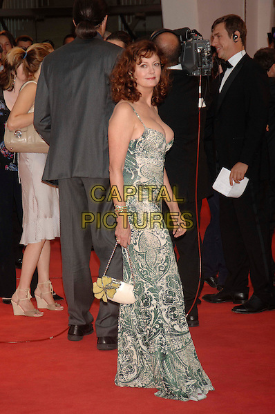 "SUSAN SARANDON.At the screening of ""Elizabethtown"".62nd International Film Festival,.Venice 4th September 2005.full length La Biennale white black floral leaf pattern strappy long dress handbag flower green purse cleavage.Ref: PL.www.capitalpictures.com.sales@capitalpictures.com.©Capital Pictures."
