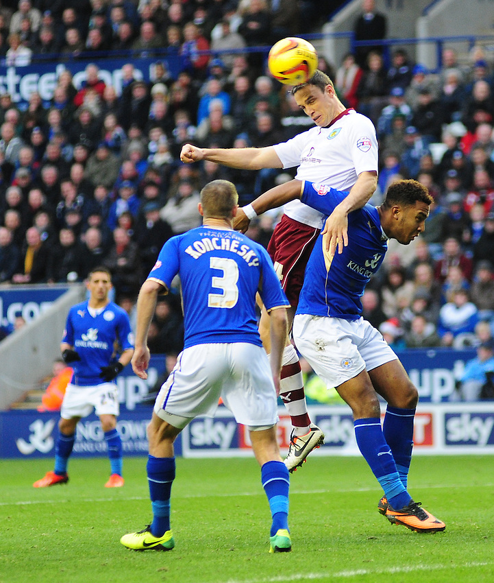 Burnley's Michael Duff vies for possession with Leicester City's Liam Moore <br /> <br /> Photo by Chris Vaughan/CameraSport<br /> <br /> Football - The Football League Sky Bet Championship - Leicester City v Burnley - Saturday 14th December 2013 - King Power Stadium - Leicester<br /> <br /> &copy; CameraSport - 43 Linden Ave. Countesthorpe. Leicester. England. LE8 5PG - Tel: +44 (0) 116 277 4147 - admin@camerasport.com - www.camerasport.com