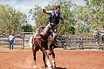 Saddle bronc rider getting buck from his horse.  Chillagoe Rodeo, Chillagoe, Queensland, Australia