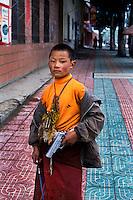 Buddhist monk with toy gun, Litang, Kham, Tibet, 2005.