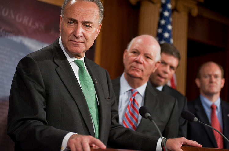 UNITED STATES - JULY 14:  From left, Sens. Charles Schumer, D-N.Y., Ben Cardin, D-Md., Mark Begich, D-Alaska, and Chris Coons, D-Del., conduct a news conference in the Capitol on the impasse in debt ceiling talks.  (Photo By Tom Williams/Roll Call)