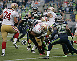 Seattle Seahawks  linebacker Bobby Wagner tackles San Francisco 49ers running back Anthony Dixon at CenturyLink Field in Seattle, Washington on September 15, 2013. The Seahawks beat the 49ers 29-3. ©2013. Jim Bryant Photo. ALL RIGHTS RESERVED.