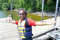 East Indian dragon boat crew member celebrating. Dragon Festival Lake Phalen Park St Paul Minnesota USA