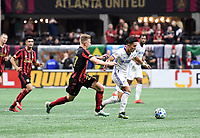 ATLANTA, GA - MARCH 07: ATLANTA, GA - MARCH 07: Atlanta United defender Laurence Wyke chases down Yuya Kubo during the match against FC Cincinnati, which Atlanta won, 2-1, in front of a crowd of 69,301 at Mercedes-Benz Stadium during a game between FC Cincinnati and Atlanta United FC at Mercedes-Benz Stadium on March 07, 2020 in Atlanta, Georgia.