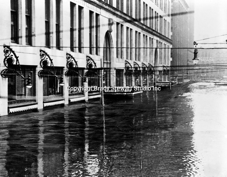 Pittsburgh PA:  View up Stanwix Street of the Joseph Horne Company Store during the flood - 1936.  On March 16, 1936, warmer-than-normal temperatures led to the melting of snow and ice on the upper Allegheny and Monongahela rivers. Heavy rains overnight caused the waters to rise quickly and the water peaked at about 46 feet, 21 feet above flood stage.