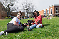 Drill Field Spring Day. Friends hanging out on the Drill Field with Bemo the dog: Kaitlyn Upton and Moesha Wright.<br />  (photo by Megan Bean / &copy; Mississippi State University)