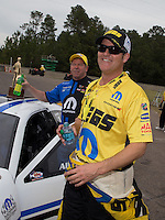 Mar. 17, 2013; Gainesville, FL, USA; NHRA runner-up, Jeg Coughlin congratulates pro stock driver Allen Johnson celebrates after winning the Gatornationals at Auto-Plus Raceway at Gainesville. Mandatory Credit: Mark J. Rebilas-