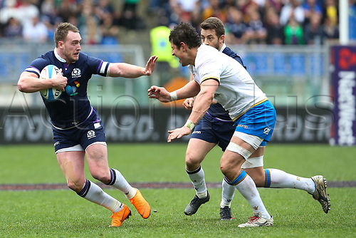 17th March 2018, Stadio Olimpico, Rome, Italy; NatWest Six Nations rugby, Italy versus Scotland; (L-R) Stuart Hogg of Scotland is challenged by Alessandro Zanni of Italy